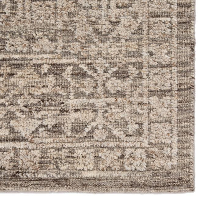 Timeless and versatile, the Brier collection effortlessly blends intricate, scrolling patterns and organic, earthy neutrals. The Sian area rug features an artisan-made Persian knot construction and stunning carved texture in the wool and viscose pile. Elegant floral and border details create a captivating design in a tonal gray and ivory colorway.  Hand-Knotted 80% Wool | 20% Viscose  BRR01 Brier Sian Rug