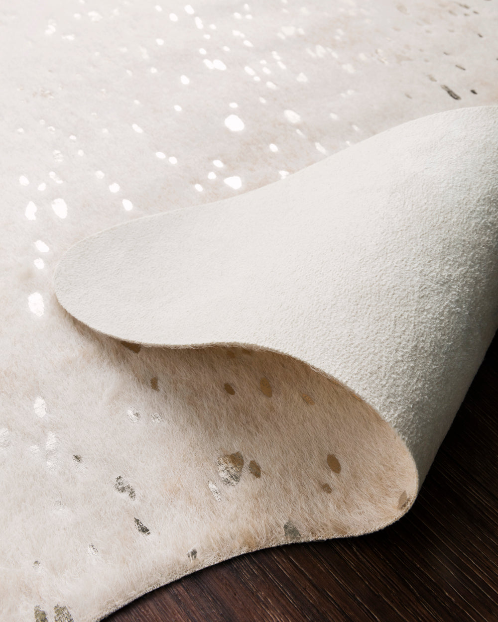 A compelling variant of the timeless cowhide rug, the Bryce Collection touts rich metallic accents set against versatile neutral tones. Power-loomed in 100% acrylic, Bryce offers long-wearing durability for your busiest living room, dining area, or entry way.  Power Loomed 100% Acrylic BZ-08 Ivory/Champagne