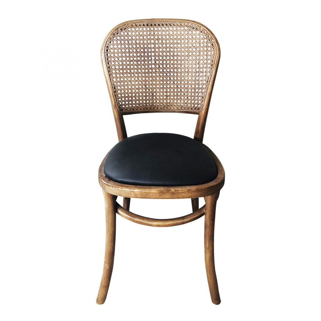 "We love the vintage vibes the Bedford Dining Chair gives with its black seat and rattan backing. A perfect dining chair for those going for a boho-chic look!  Size: 16""W x 16""D x 34""H Seat Height: 18.11"" Materials: Rattan, Solid Elm, Polyurethane Seat, Foam"