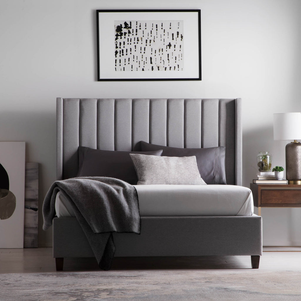 "The Blackwell Stone Designer Bed by Malouf has a gorgeous tall, padded frame that exudes comfort and calmness. We love how these can fit the M555 adjustable bed base for those who want more control over their sleep   Full: 82.3""l x 62.6""w x 55.8""h Queen: 86.6""l x 68.11""w x 55.8""h King: 86.6""l x 84.25""w x 55.8""h California King: 92.3""l x 80.12""w x 55.8""h"
