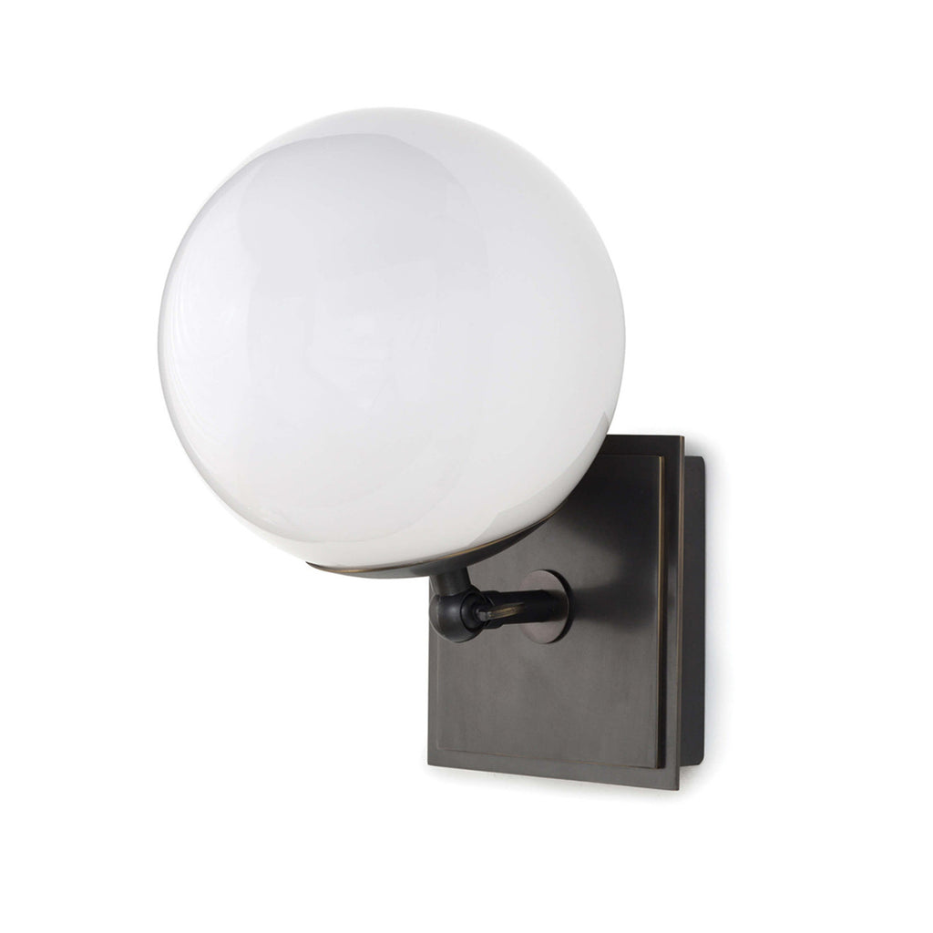"The Bodie Sconce has a sleek sphere glass globe with an adjustable head for varying ambience. A timeless choice for your living room, office space, or bathroom.   Overall Dimensions: 7""w x 10.25""d x 7""h"