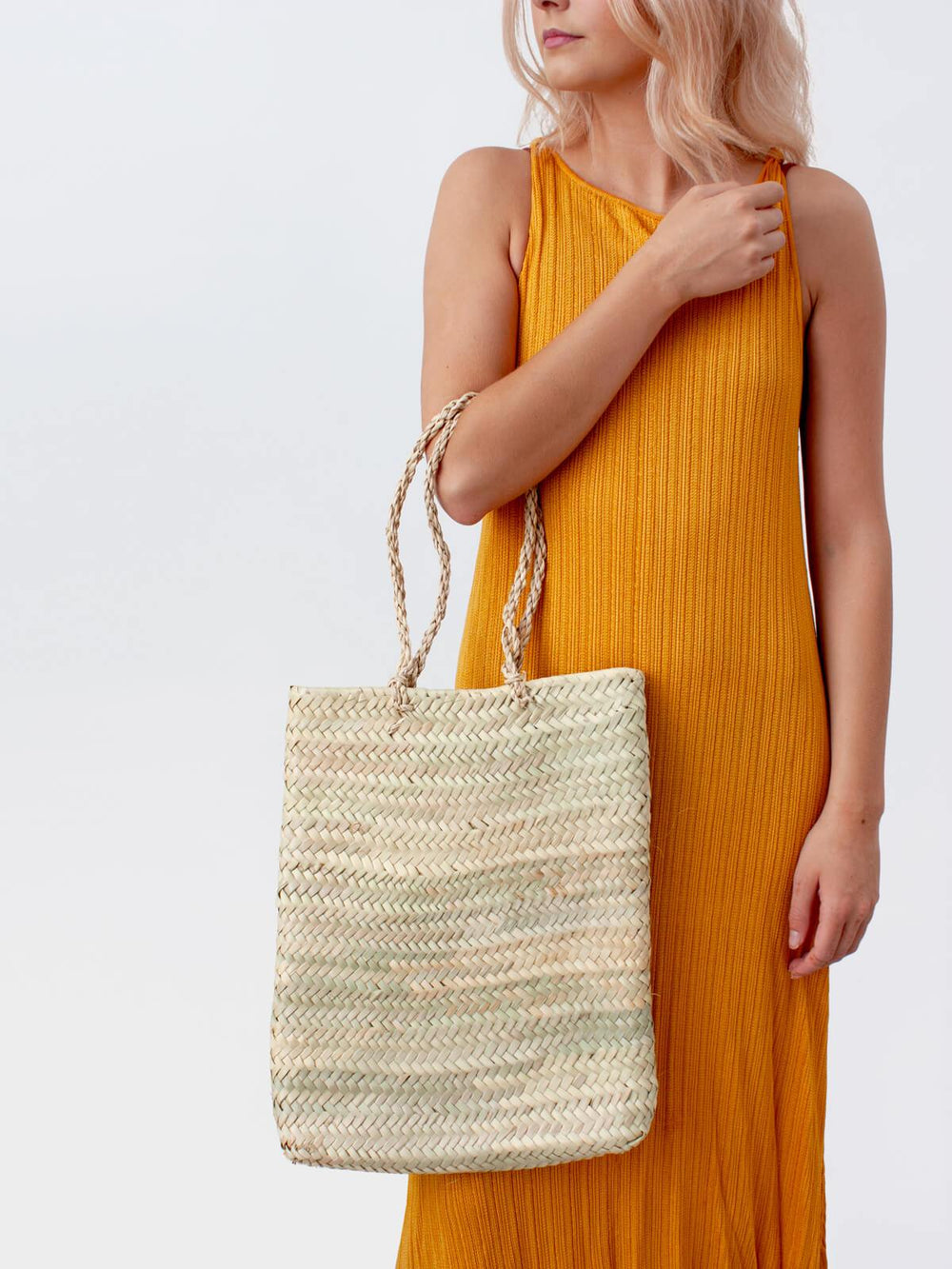 The Delphi Tote Basket is handwoven by artisans in Moroccan using palm leaf. Tall and rectangular in shape, the long sisal handles make it a practical and contemporary basket bag for carrying daily essentials.