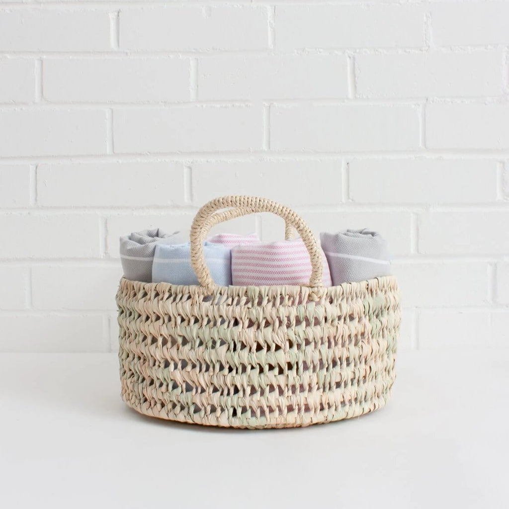 The Medium Round Storage Basket is handwoven in Moroccan in a robust open weave using sustainable palm leaf and can be used as fruit bowls, bread baskets or an ideal home storage solution.