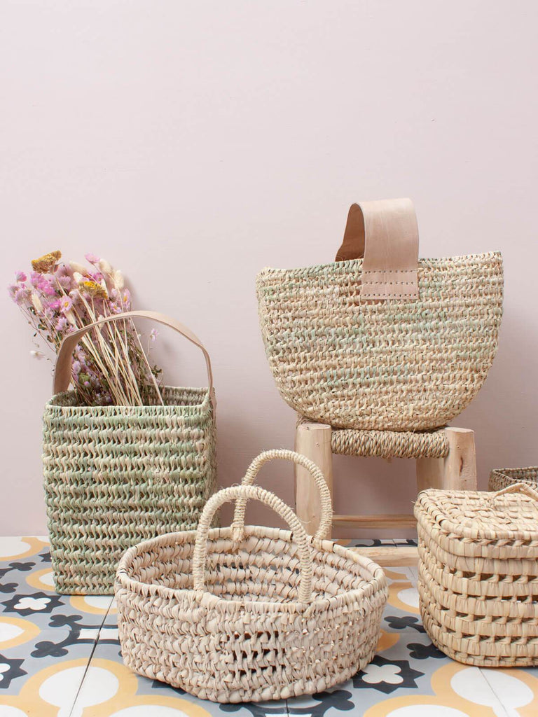 The Small Round Storage Basket is handwoven in Moroccan in a robust open weave using sustainable palm leaf and can be used as fruit bowls, bread baskets or an ideal home storage solution.