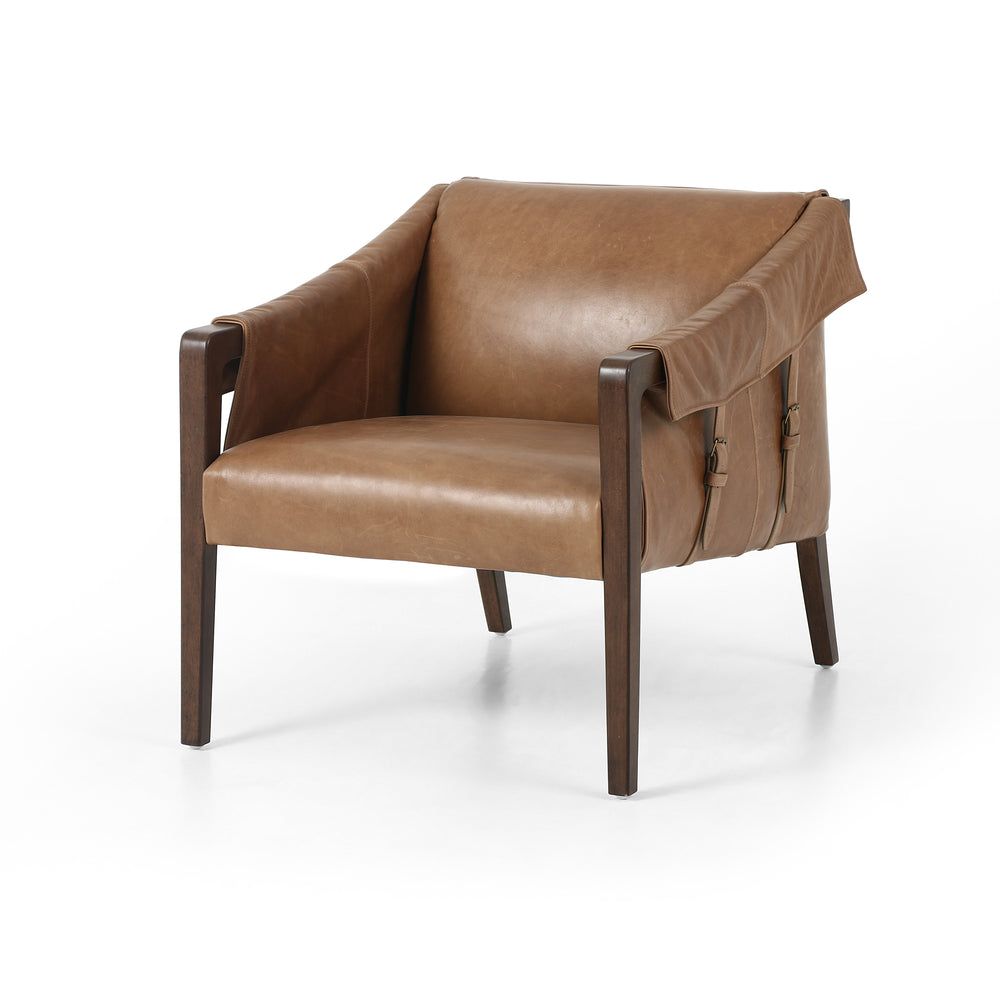 "The Bauer Leather Chair is a favorite lush seating of taupe top-grain leather fastens to almond-finished parawood framing via trend-forward buckles. The ebony top-grain leather fastens to grey birch framing via trend-forward buckles. Angular arms honor mid-century design, adding a throwback feel to a cutting-edge look.  Overall Dimensions: 27.00""w x 35.00""d x 29.00""h Seat Depth: 21"" Seat Height: 17"" Arm Height from Floor: 23"" Arm Height from Seat: 6"""
