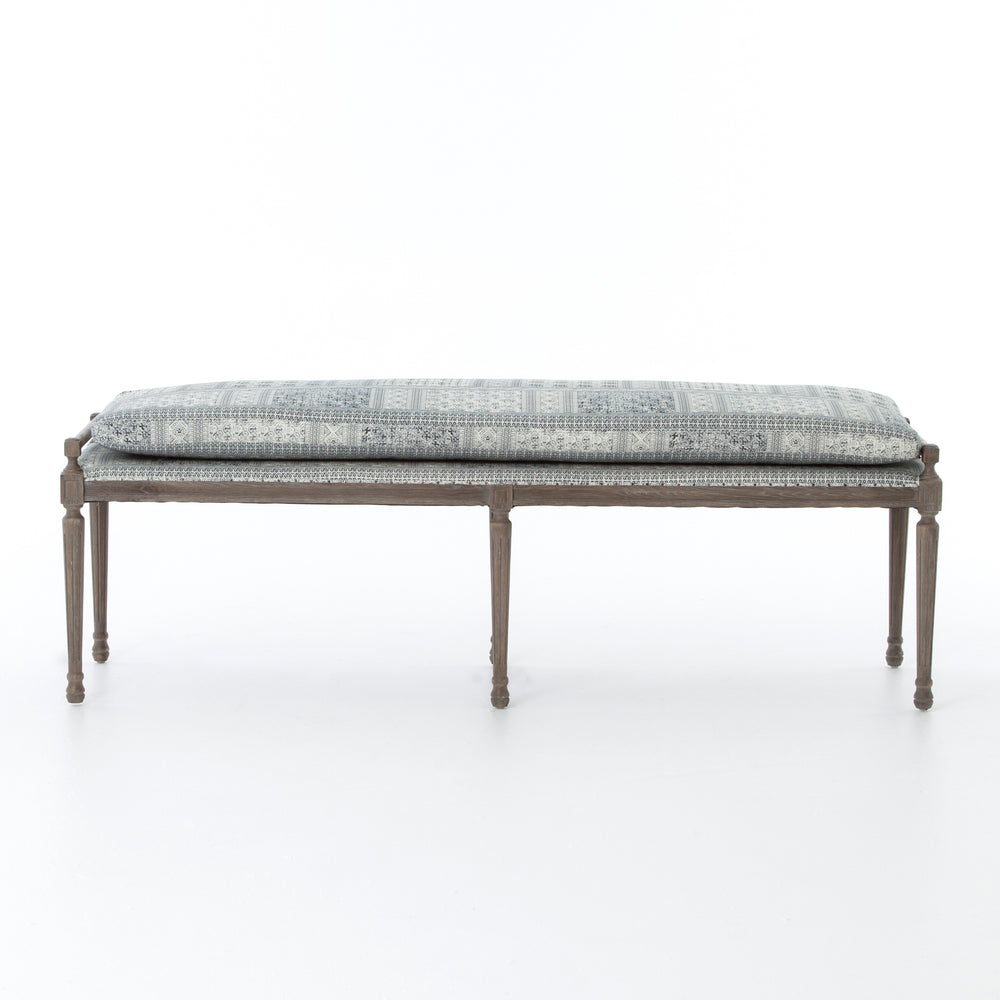 Perfect for dining or at the end of a bed, this elegant bench pairs a 100% cotton blue and white batik cushion with delicate, traditional Swedish routed wooden legs. Each bench is hand-made and will vary slightly.