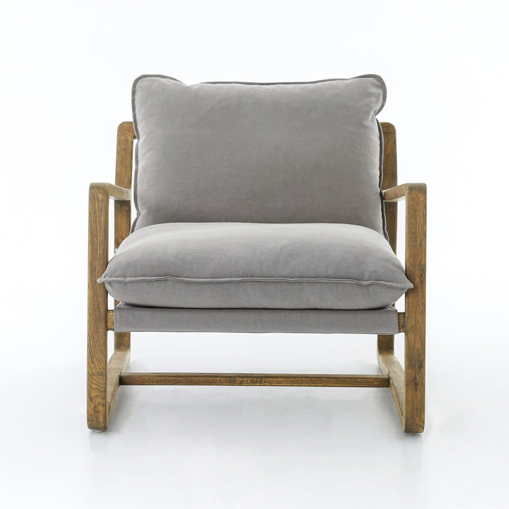 "The Ace Robson Pewter Chair is the perfect place to relax or curl up with a good book. Hand-shaped oak frame supports deep, low seating covered in soft, 100% cotton.  Available for shipment Mid September 2020.   Overall Dimensions: 30""w x 37.5""d x 34""h Materials: 100% Cotton, Oak\"