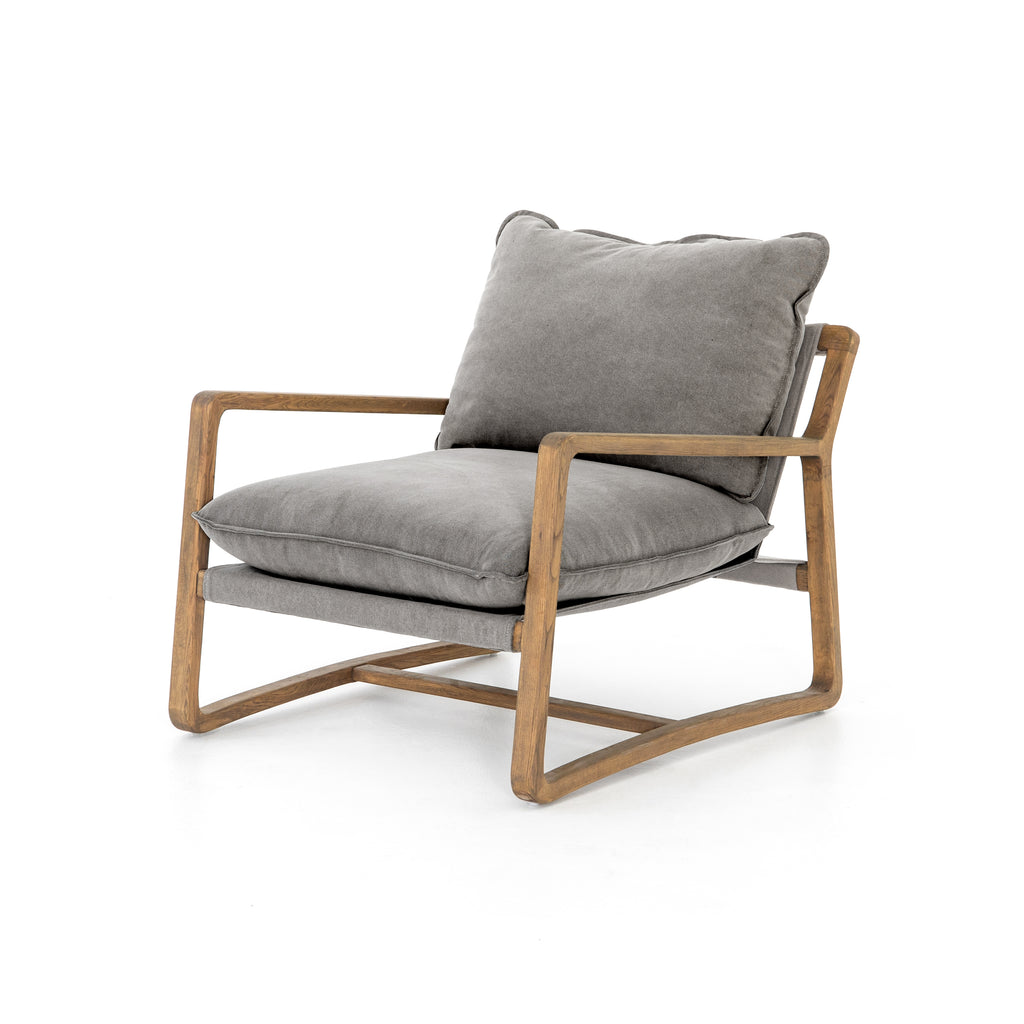 "The Ace Robson Pewter Chair is the perfect place to relax or curl up with a good book. Hand-shaped oak frame supports deep, low seating covered in soft, 100% cotton.  Available for shipment Mid September 2020.   Overall Dimensions: 30""w x 37.5""d x 34""h Materials: 100% Cotton, Oak"