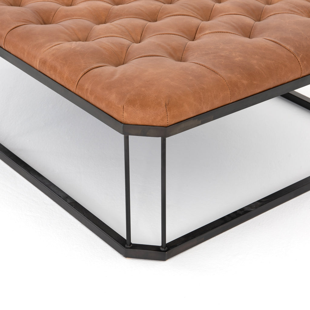 A new take on the ottoman, the Isle Ottoman intrigues with leather in dramatic diamond-tufting, angled corners and open iron base.