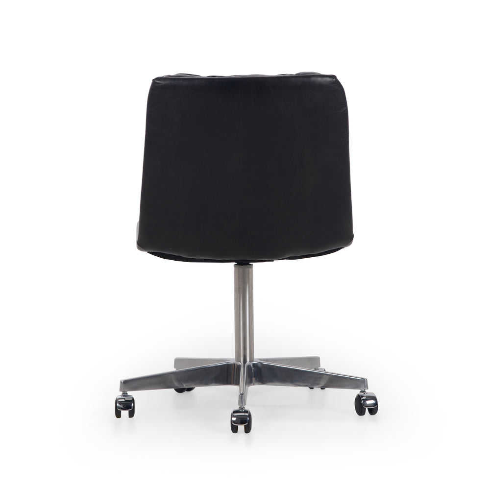 "Paired back and fashion-forward, this minimalist Malibu Desk Chair in black top-grain leather offers maximum comfort. Inspired by workspaces of the '50s and '60s. Stainless steel casters make for stylish ease in the workplace. Height not adjustable.  Overall Dimensions: 20.75""w x 26.25""d x 34.25""h Seat Depth: 16.54"" Seat Height: 19.29"""