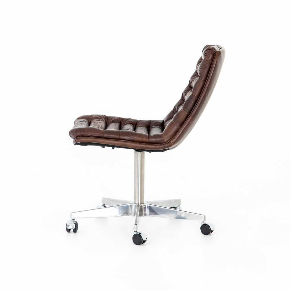 Paired back and fashion-forward, this minimalist desk chair in a dark chestnut top-grain leather offers maximum comfort. Inspired by workspaces of the '50s and '60s. Stainless steel casters make for stylish ease in the workplace. Height not adjustable.