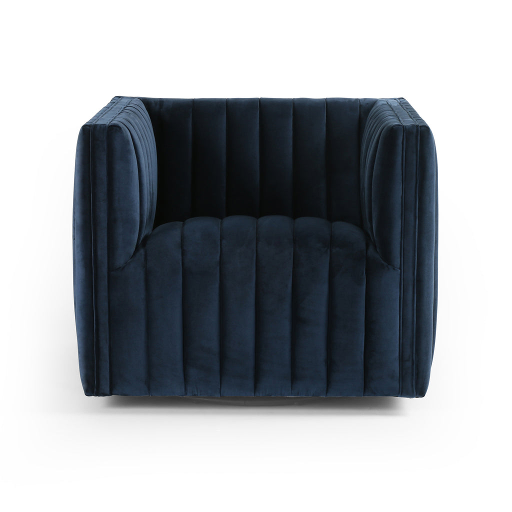 "A modern take on classic library chair, the Augustine Sapphire Navy Swivel Chair is a luxurious poly-blend navy seating that takes on dramatic channeling for trend-forward texture and sumptuous sit. Swivel feature amps up fresh appeal from every angle.  Size: 32""w x 34""d x 26.5""h Seat Depth: 23"" Seat Height: 17"" Arm Height from Floor: 26.5"" Arm Height from Seat: 9.5"""