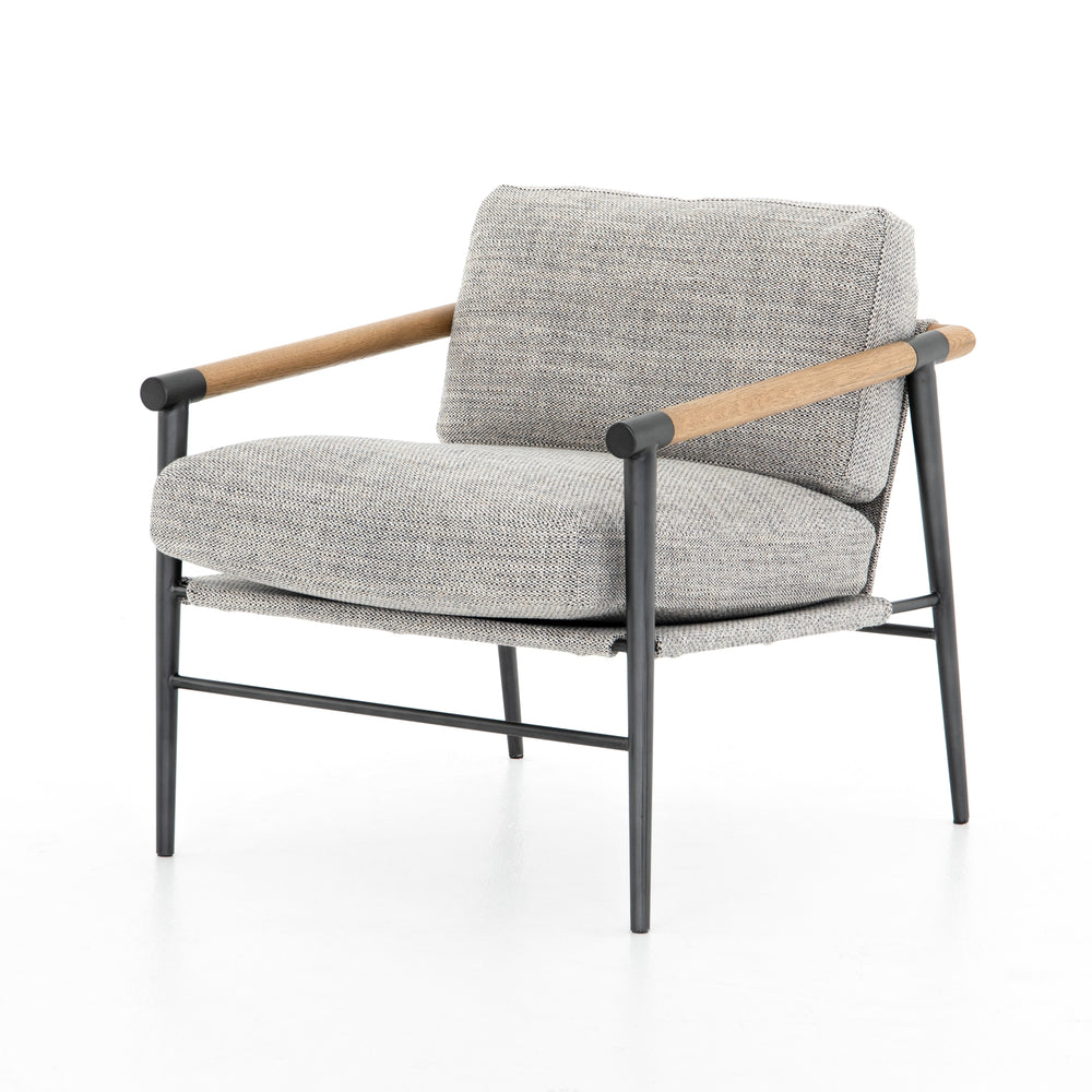 Textural grey seating of performance-grade upholstery, with angular arms of exposed oak providing fresh contrast. Slim, carbon-finished steel legs for a dose of modern-industrial edge.