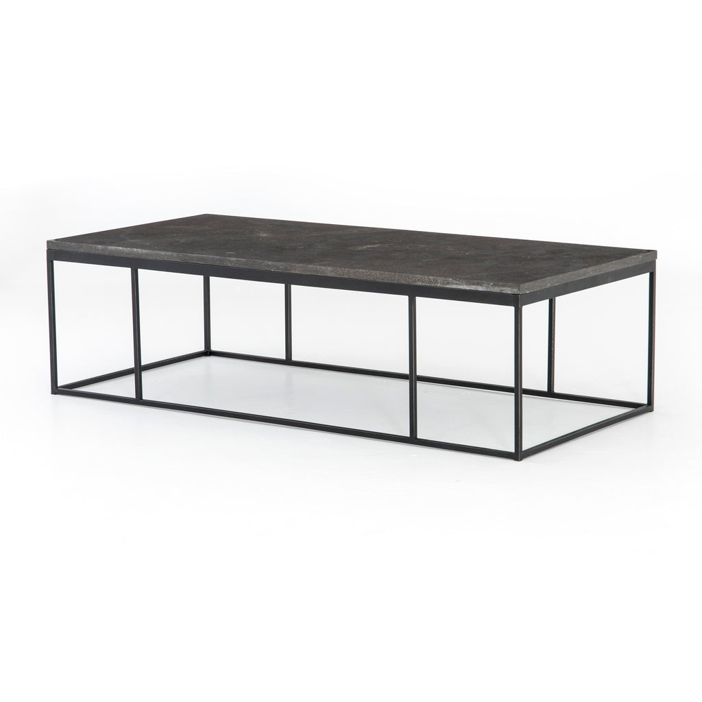 "Spare beauty, casual elegance with the Harlow Bluestone Small Coffee Table. A gunmetal Parson's base with hand-rubbed, dimensional edges supports a rough-hewn bluestone slab that feels found and perfectly placed.  Size: 60""w x 28""d x 17""h Materials: Iron, Limestone"