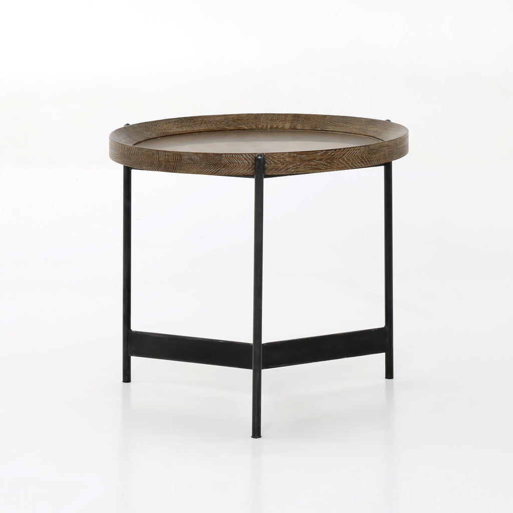 "Slimly styled industrialism is front and center in the Nathaniel End Table. The end table features a powder black-finished iron base. The table base supports a rounded top of light burnt oak for a fresh twist on the tray table.  Size: 21.75""w x 22""d x 20""h"