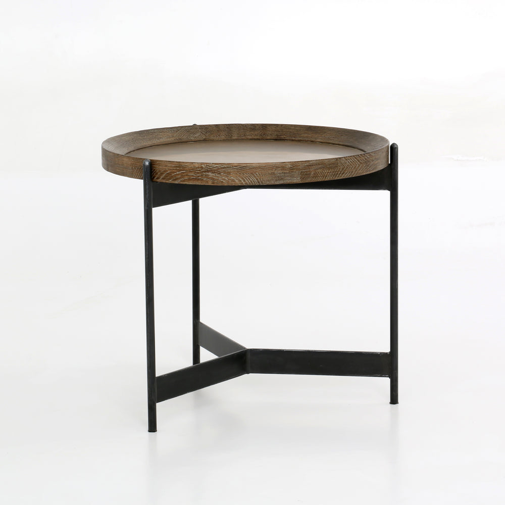 Slimly styled industrialism. A powder black-finished iron base supports a rounded top of light burnt oak for a fresh twist on the tray table.