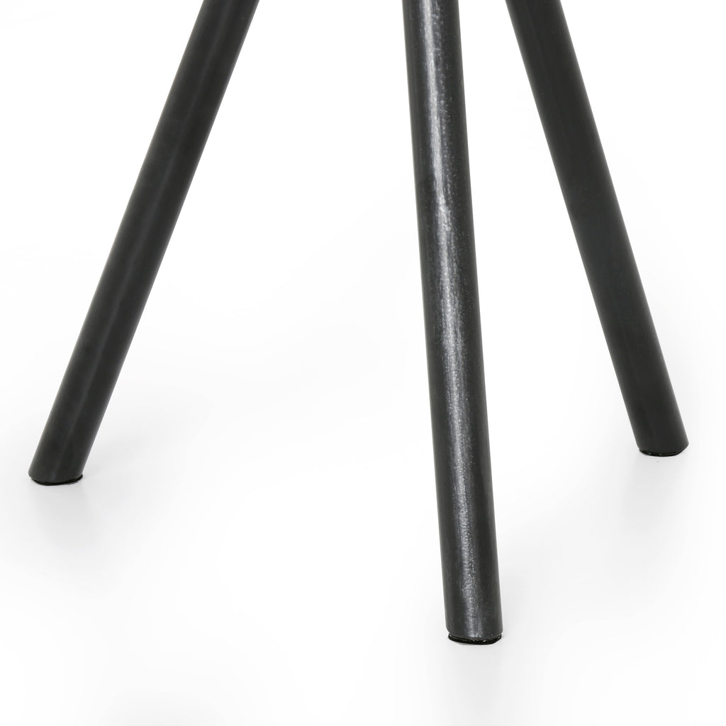 This Corin Bluestone / Powder Black End Table has a classic tripod base of powder black-finished iron supported by a rounded bluestone top. The simply styling makes for the perfect end table.