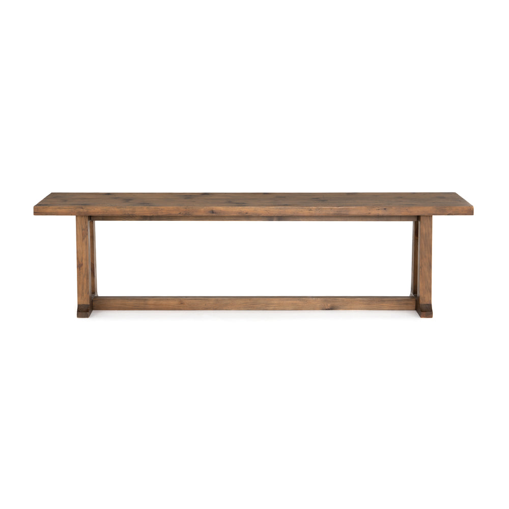 "The Otto Dining Bench 71"" is finished in a warm honey hue, a trestle-style base of reclaimed pine supports a bench seating of pine, waxed and bleached for a rustic look with natural depth. We love that it brings a traditional feel to the dining room. Pair on its own or with matching dining table.  Overall Dimensions: 71""w x 17""d x 19""h"