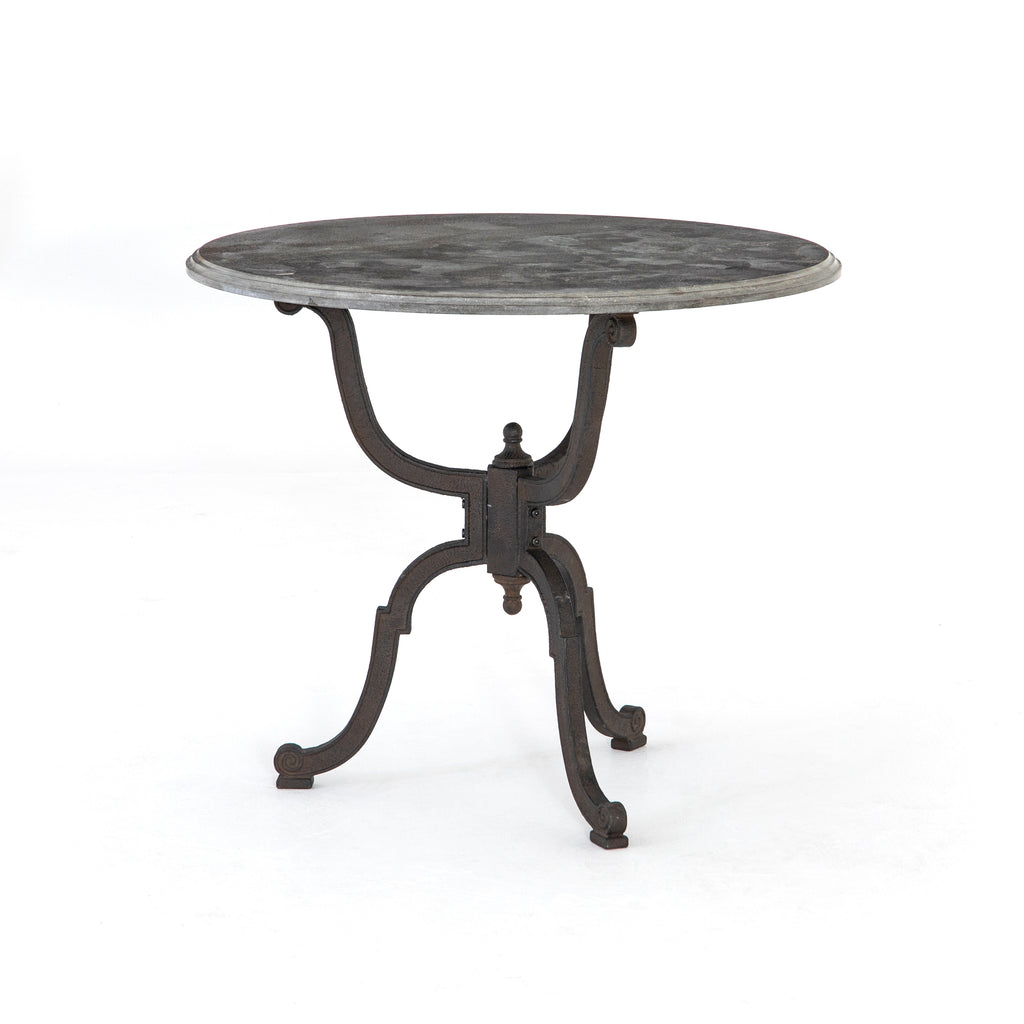 Solid cast iron reveals French industrial inspiration. The mirrored cabriolet underpinnings hold a beautiful, thick bluestone top with a carved edge. Perfect as a bistro table or as a large night stand.
