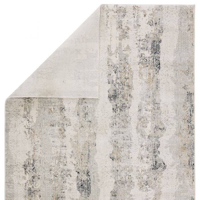 The Cirque collection artistically melds contemporary appeal with the timeless and intricate beauty of Oriental designs. The Jaspal area rug features an intricate, textured Turkish pattern with tribal details and striped abrash. The white, dark gray, and mottled gold tones create a vintage look on this power-loomed viscose and polyester rug.  Power Loomed  70% Shrink Polyester | 30% Viscose CIQ35 Cirque Jaspal Rug