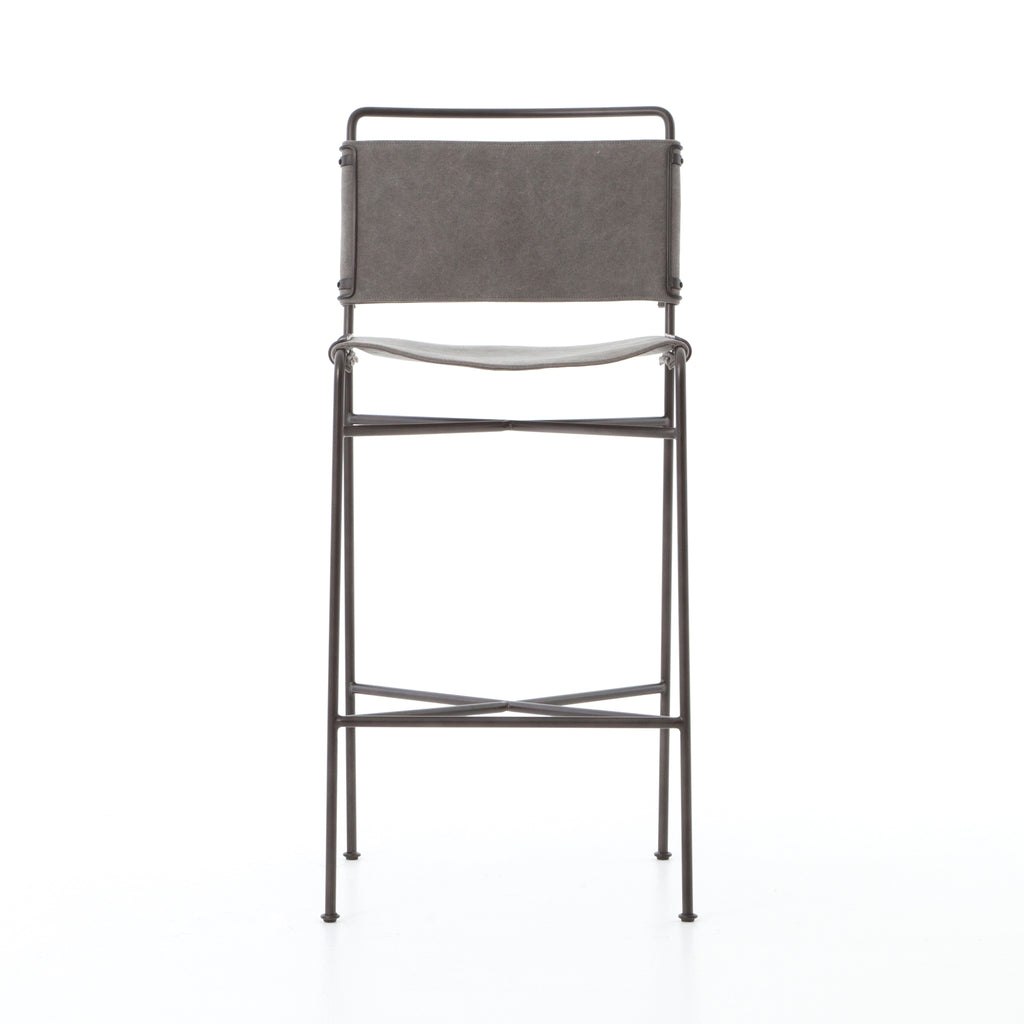 The Wharton Bar and Counter Stool in a stonewash grey feature slim lines and mixed materials combined for ultimate comfort. The architecturally inspired steel tubing is graced by simply contoured cotton seating.