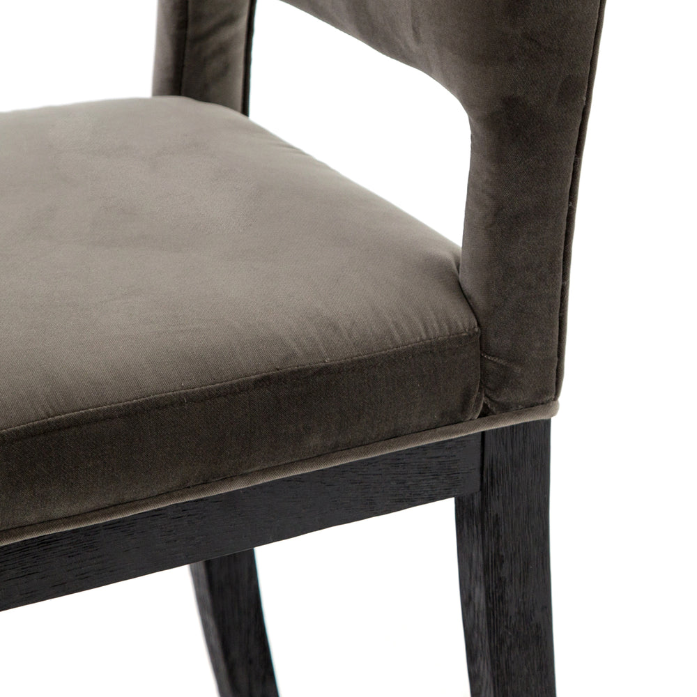 The natural graining of black oak framing complements velvety grey seating for a unique textural contrast.