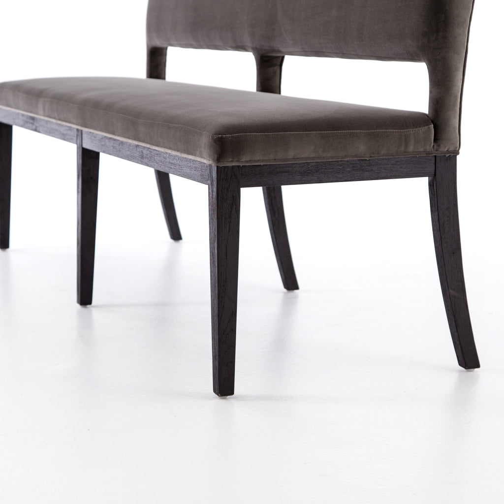 The natural graining of black oak framing complements velvety bench-style seating in deep grey. Great paired or mixed with traditional dining chairs for an eclectic look.