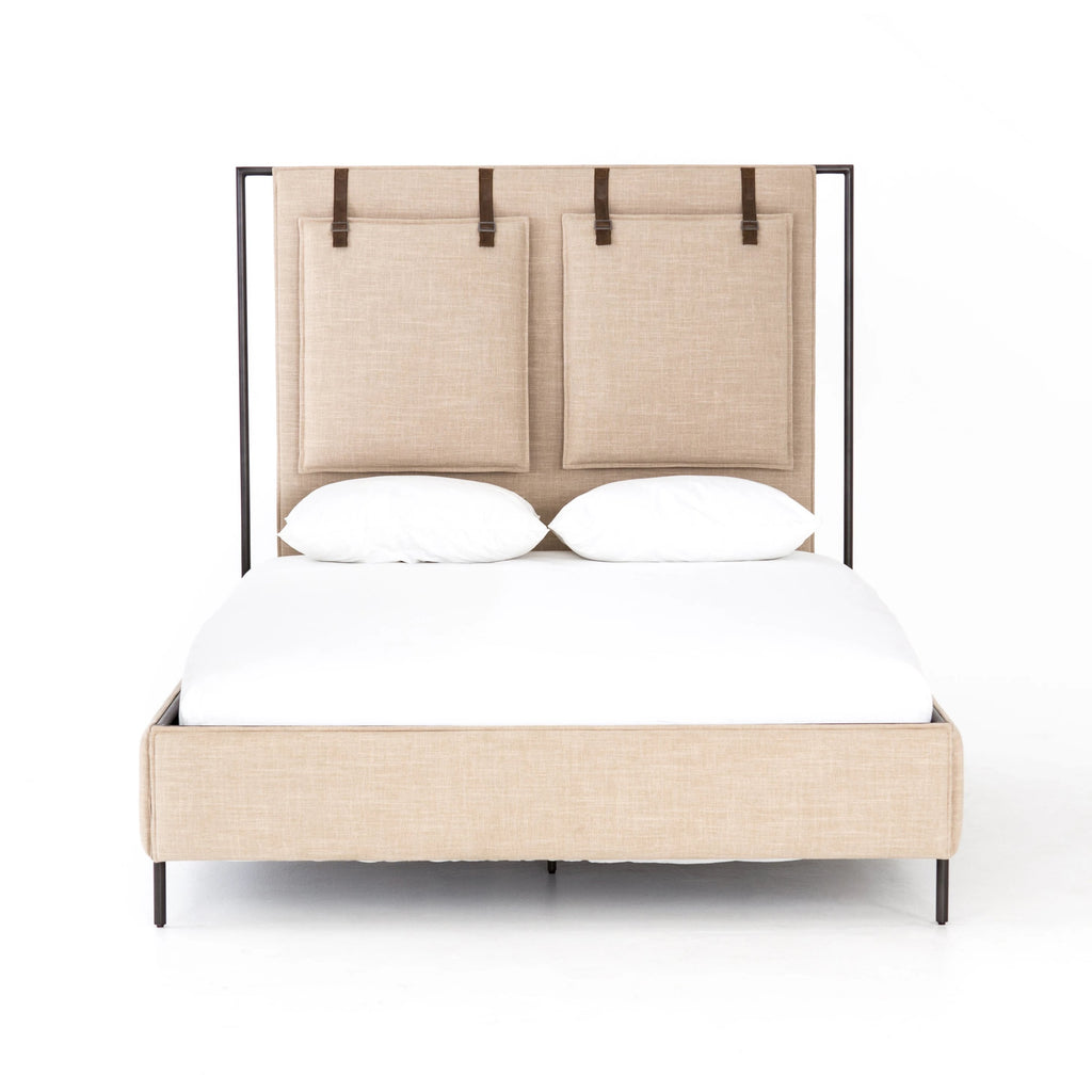 Safari styling gets a modern reboot with this Leigh Upholstered Bed. Linen-blend upholstery of neutral taupe lays a texture-rich base for a forward-thinking bedroom look. Brown leather straps secure decorative headboard pillows, suspended for eye-catching effect. Box spring required.