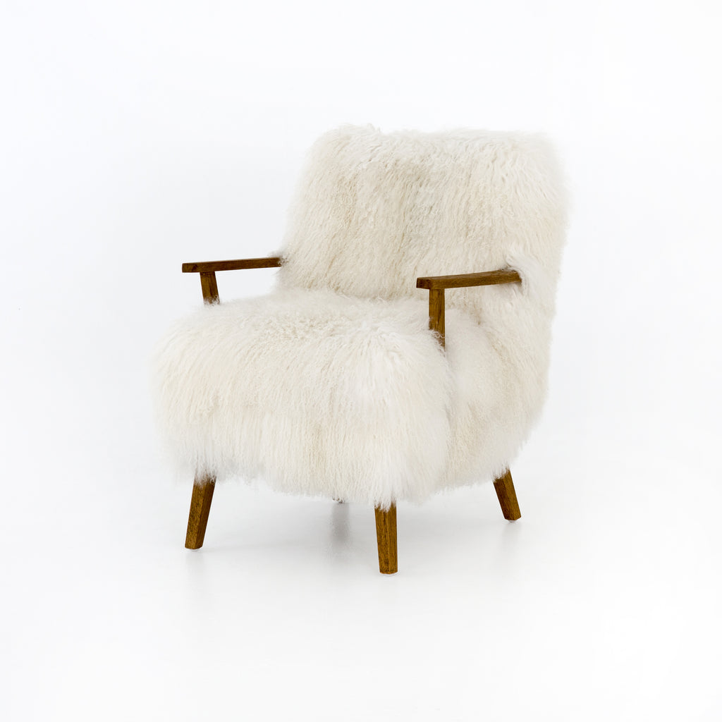 "The Ashland Mongolia Cream Armchair is a modern statement-maker. We love the sculpted arms of drifted oak emerge from shaggy, cream-colored seating of Mongolian fur.  Overall Dimensions: 25.00""w x 29.25""d x 32.00""h Seat Depth: 19.25"" Seat Height: 18.5"" Arm Height from Floor: 23.5"" Arm Height from Seat: 5"""