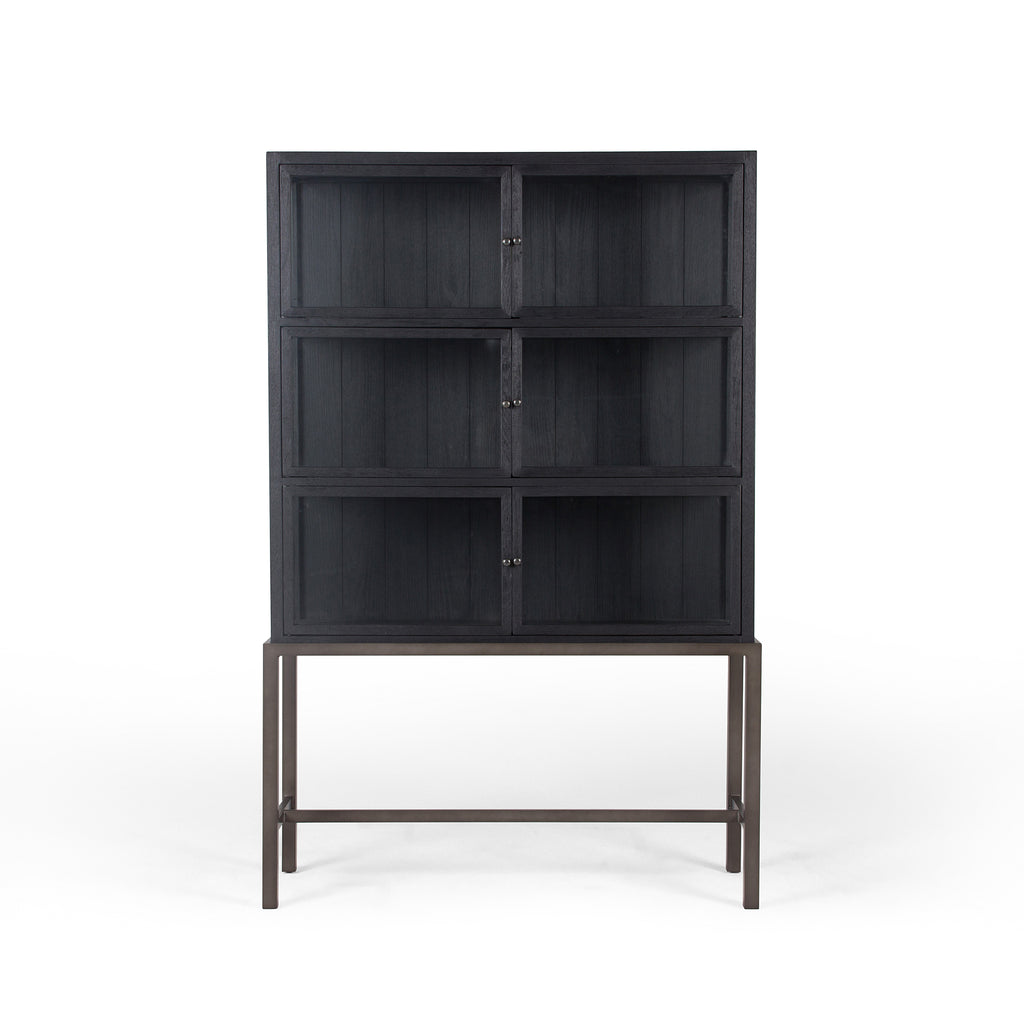 "We love how the Spencer Drifted Black Curio Cabinet is perched on a simple, waxed black iron pedestal. The rustic black-finished oak forms an airy curio cabinet designed to showcase life's artifacts.  Overall Dimensions: 45.75""w x 16""d x 69""h Materials: Plywood & Oak Veneer, Iron, Glass, Oak"