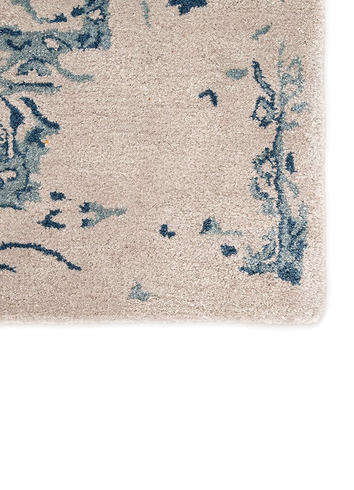 The Citrine collection is an assortment of distressed Old World patterns reinterpreted for modern design. The hand-tufted Margate rug features a distressed Oriental pattern of elegant floral details in a light, warm gray and tonal blue colorway. Made of wool and viscose, this timeless rug boasts a plush and inviting feel underfoot.  Hand Tufted 50% Wool | 50% Viscose CIT06