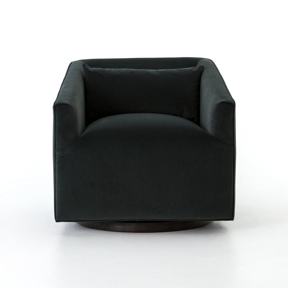 The York Swivel Chair is small in scale, but substantial in comfort. The chair's precisely-tailored seating in a modern smoky velvet offers a touch of light swivel movement. The base of the chair has a moss-tinged charcoal hue adding a fashion-forward twist.