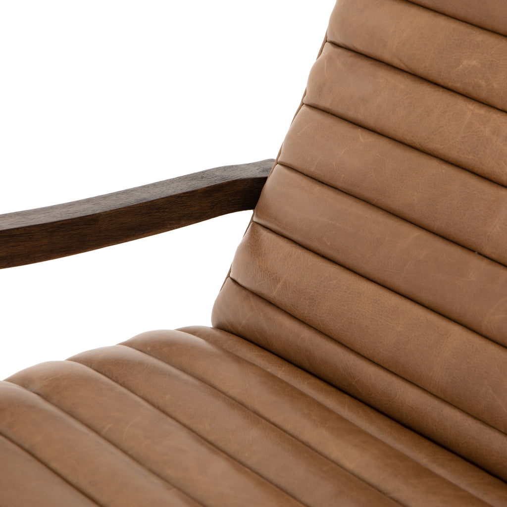 "The Chance Recliner has an invitingly curved seat with dramatic horizontal channels is covered in soft, camel-colored top-grain leather. Rich, tonal frame captures alluring negative—and positive—spaces. A push recliner takes this forward-thinking lounger to the next level.  Overall Dimensions: 27.50""w x 56.00""d x 36.00""h Seat Depth: 20.25"" Seat Height: 18"" Arm Height from Floor: 24"" Arm Height from Seat: 6"""