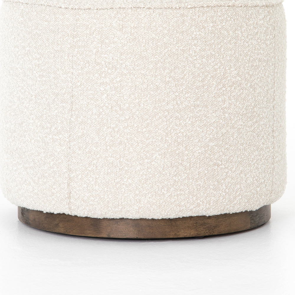 This round ottoman of textural cream boucle can be placed just about anywhere, bringing with it a hip retro vibe.