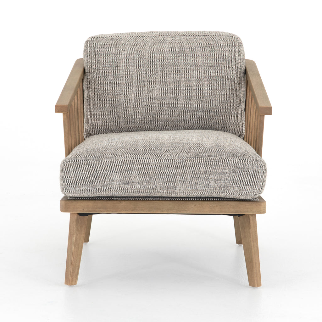 "The Ariel Chair-Thames Coal has spindle detailing for an airy look, with angular wooden arms and cleverly positioned legs, plus feather-blend cushioning covered in a textural performance-grade upholstery.  Size: 29""w x 35""d x 31""h"