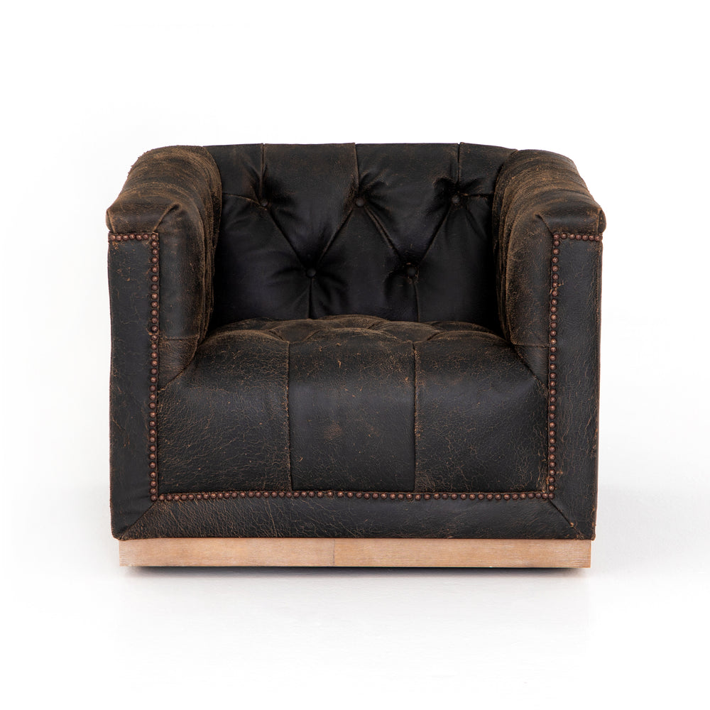 This modern take on the classic library chair is covered in distressed black top-grain leather and mounted on a smooth swivel base of weathered oak.