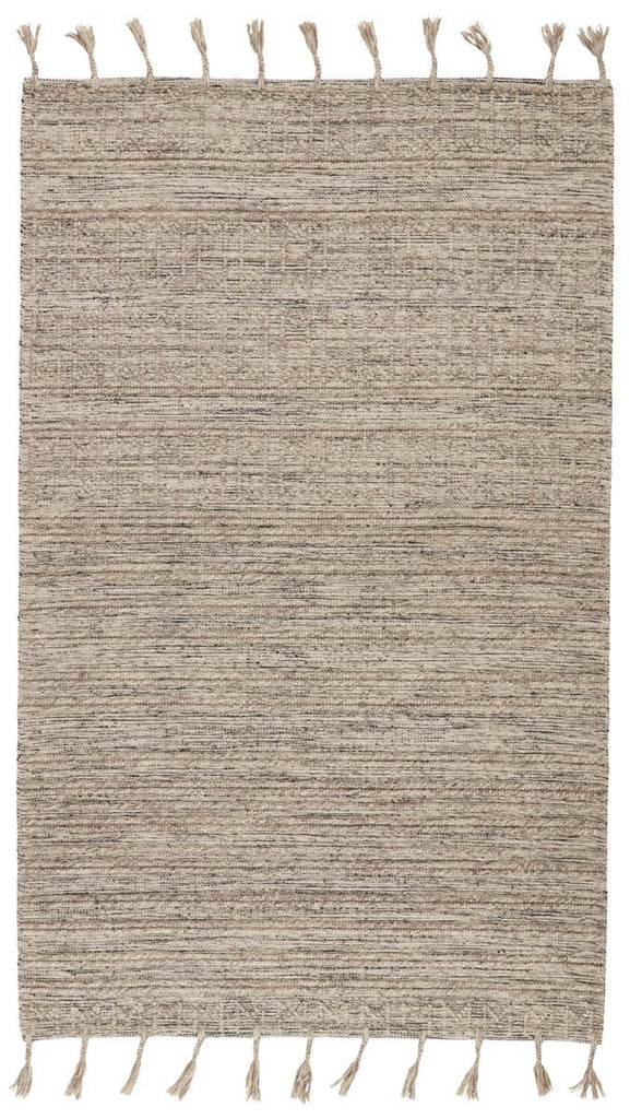The Calixta Palisades Area Rug by Jaipur Living, or CAX03, features a light taupe colorway with interwoven yarns of black and cream for added dimension. The raised boucle linear motif and braided fringe details lend a global vibe to this handcrafted rug. A beautiful rug for the entry way or other high traffic area.