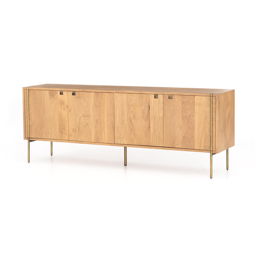 "The slim, satin brass finished legs on the Carlisle Sideboard give this modern sideboard an antique feel. The doors open to shelves, making it extremely functional for those needing extra storage Size:  82.00""w x 18.00""d x 30.00""h Materials: Iron, Mango"
