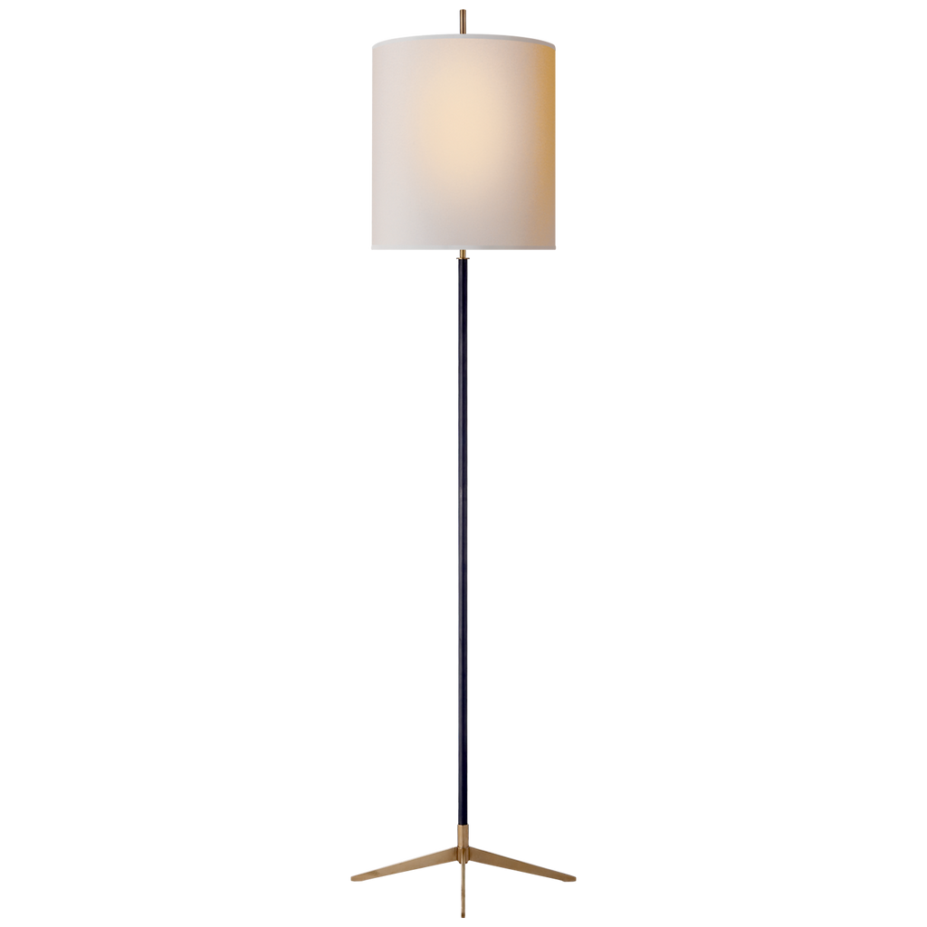 The Carol Floor Lamp has a gorgeous natural paper shade matched with a simple, yet classic base. Sure to add a warm glow to any living room, office, or other area needing extra lighting  Designer: Thomas O'Brien