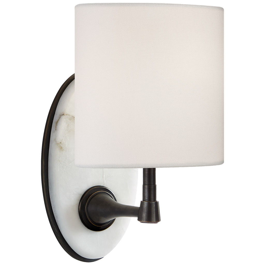 The Casper Small Sconce is attached to a slab of alabaster with a unique, oval-shaped linen shade. This adds an elegant, earthy vibe to any bathroom, hallway, or other area needing extra light