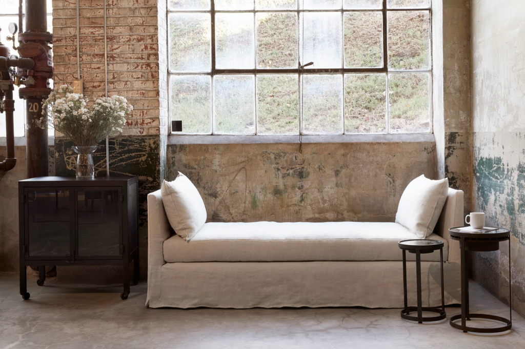 The April Daybed by Cisco Brothers is one of our favorite, most versatile pieces for any room in your home. Photographed in Brevard Birch and Otis White.