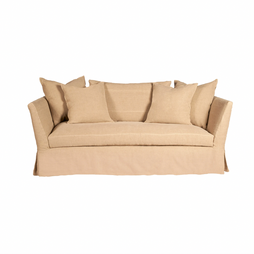 The Seda Sofa  - Essentials embodies a blithe, carefree coastal spirit. It's simple silhouette is accented with a kick pleat bottom for a hint of refinement. It's wide, open arms and ample bench seat invite you to take it easy and just enjoy. This comes upholstered or slipcovered.