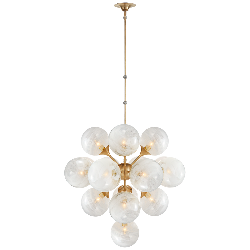 "We love the white strie glass globes on this Cristol Hand Rubbed Antique Brass Large Tiered Chandelier. It brings a stunning and unique look to any living room, dining room, or kitchen  O/A Height: 62"" Min. Custom Height: 41"" Width: 33.25"" Canopy: 6"" Round"