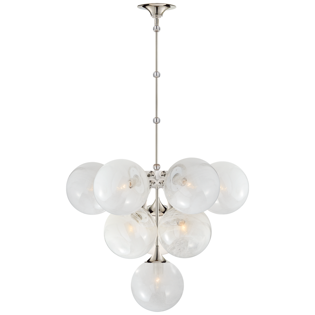 We love the white strie glass globes on this Cristol Medium Chandelier by Visual Comfort. It brings a stunning and unique look to any living room, dining room, or kitchen  Designer: AERIN