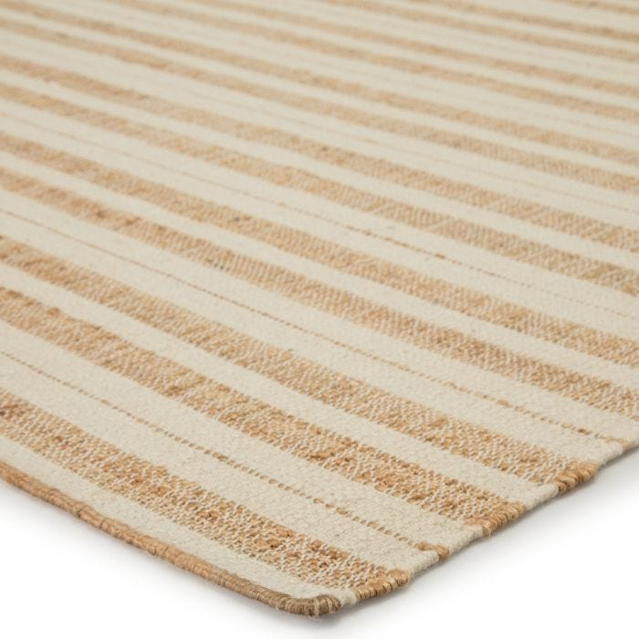 The Dorada collection blends a relaxed, warm style with effortless modernity. The flat-woven Rey rug is crafted of jute and wool for a fine, soft foundation underfoot. The natural golden, tan, and ivory colorway offers versatility to any space.  Handwoven 50% Wool | 50% Jute DRD01 Dorada Rey Rug