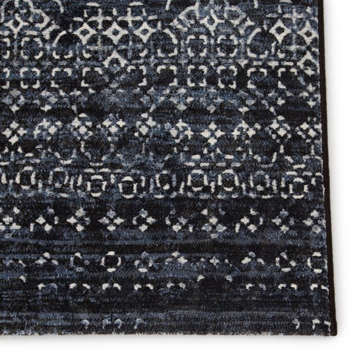 The durable and easy-care Dash collection boasts textural designs and worldly appeal. The Ardor area rug showcases a deep indigo and light gray Moroccan trellis motif for instant impact and globally inspired beauty. This power-loomed polyester rug is perfect for high-traffic spaces and provides cozy cushioning underfoot with a high-density pile.  Power Loomed  100% Polypropylene  DSH19 Dash Ardor Rug