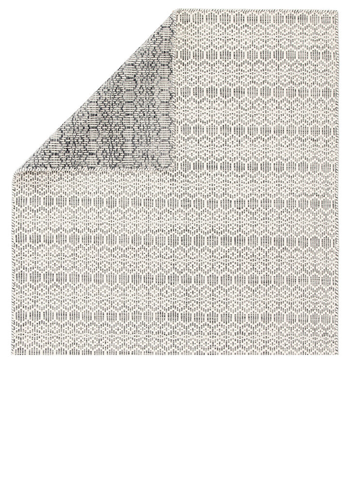 Minute details and a 100% wool construction define the relaxed yet stylish appeal of the Enclave collection. The durable Calliope dhurrie rug boasts a playful and neutral geometric lattice design of honeycomb and diamond shapes. The ivory and gray color palette grounds contemporary spaces with a light, versatile scheme.  Flat Weave 100% Wool ENC01