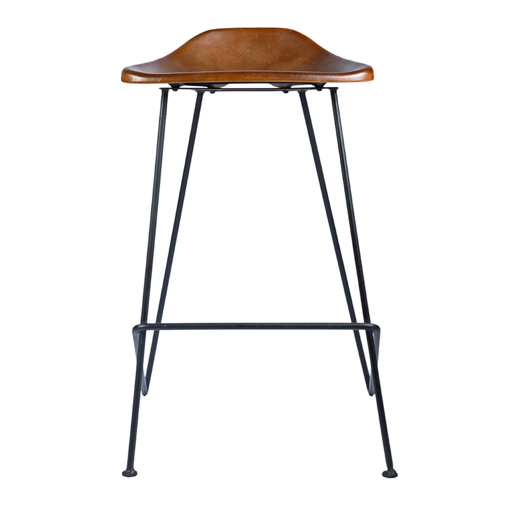 The Equestrian Bar Stool blends utilitarian and rustic design to evoke a modern style. The stool is supported with a gun metal frame and a comfortable brown leather seat.