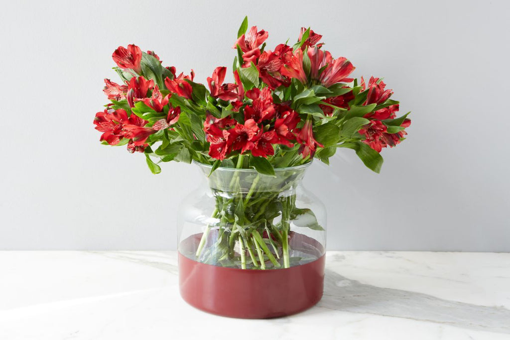 "Made from the recycled glass, this Merlot Colorblock Flower Vase adds a bold splash of color to any room. Perfect vase to hold your flowers   Size: 8""d x 8.5""h"