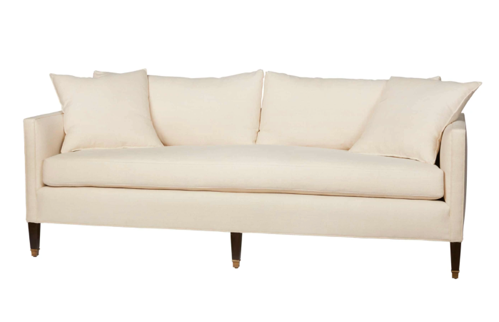 "The Evelyn Sofa by Cisco Brothers is an updated twist on traditional silhouette. This piece has an enduring style, with a comfortable bench seat and butterfly pleats on the back cushions. This sophisticated design is elevated with subtle details like the elegant brass cuffs on the legs and would complete the look for any living room or lounge area.   Overall: 84""w 36""d 28""h"
